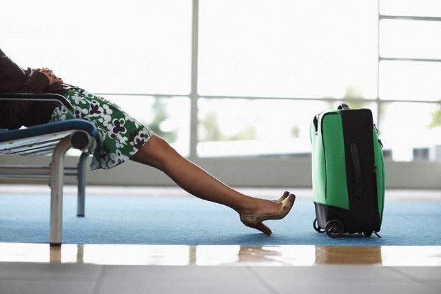 Woman in Airport Waiting Area --- Image by © Radius Images/Corbis